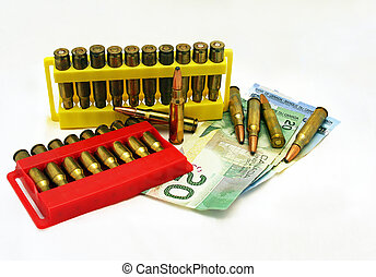 Bullets and Canadian Money - A photo of rifle bullets and...
