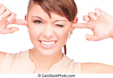 smiling woman with fingers in ears - picture of smiling...