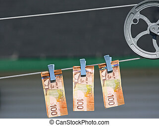 Canadian Money on Clothes Line - A photo of 3 Canadian...