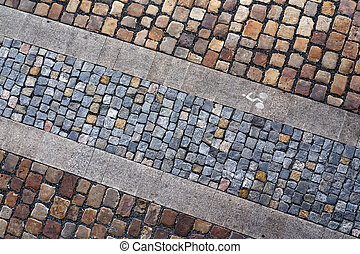 Bicycle path from a stone blocks