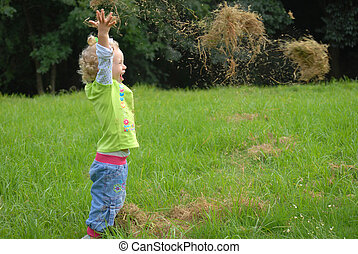 Funny litlle girl playing with grass - Blondie girl playing...