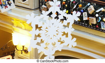 Huge snowflake in a shopping center - Hanging at mall is...