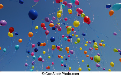 sky ful of colors - ballons covering the blue sky on a...