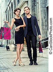 promenade - Attractive young couple shopping in the city...