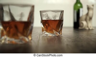 Pouring whiskey in two glasses - Whiskey or cognac in two...