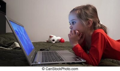 Little girl at night watching cartoons - Little girl...