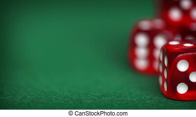 Red dice rotation on a green felt