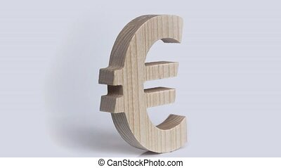 Wooden euro symbol rotation on a white background - Russian...