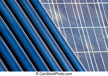 Solar heating tubes in front of a solar panel - solar...