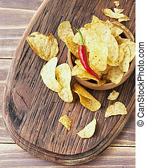 Chips in a wooden bowl on table