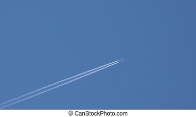 Airplane disappearing vapor trails and satellite - Airplane...