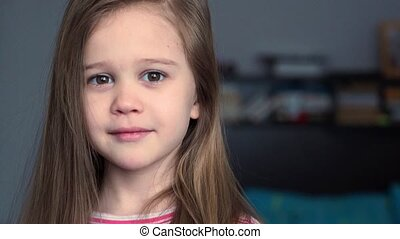 Close up portrait of emotional little girl