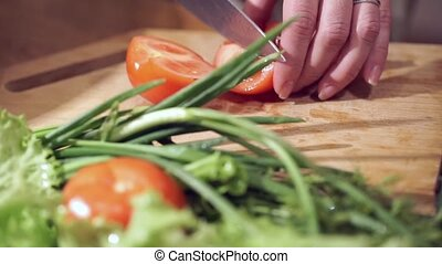 Cooking and home concept. Cutting tomato.