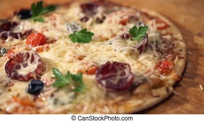 Pizza with ham, pepper, tomato and olives