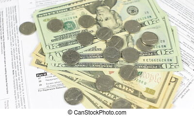 Dollars and Tax Forms Rotating - Dollars and tax forms...
