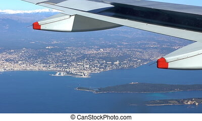 Aircraft wing over land - Aircraft wing above water surface...