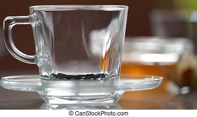Transparent cup of tea on the table - A cup of tea on the...