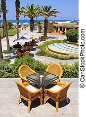 mediterranean beach hotel resort and al fresco wicker seats,...