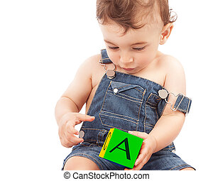 Little boy learning letters