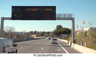 Motorway in Kannes, France with roads pointers