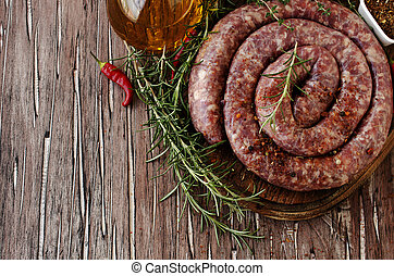 raw beef sausages on a cast-iron pan, selective focus - raw...
