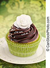 Rose cupcake - Cupcake decorated with chocolate frosting and...