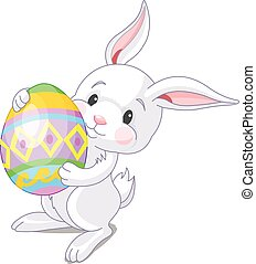 Easter Bunny - A cute Easter bunny carrying brightly colored...