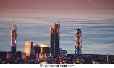 Sunset timelapse Batumi cityscape pan down - HD Sunset...