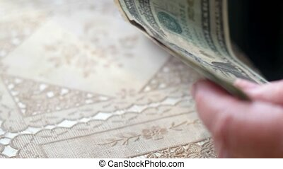Senior retired woman count dollar money on table, toned,...