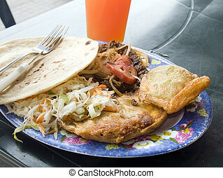 mixed plate of street food leon nicaragua - plate of mixed...