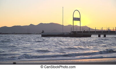 French Riviera at sunset - Cote d'Azur at sunset in Cannes,...