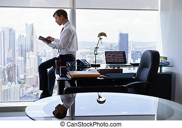 Business Person Reads News On Tablet PC In The Morning