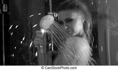 sexy woman taking shower - sexy woman in her bathroom taking...