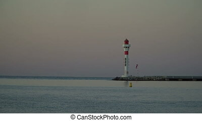 The lighthouse at sunrise - The lighthouse at the edge of...