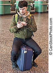 Man with smartphone at the airport
