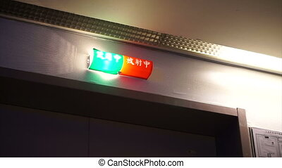 CT scan operation lighting and caution sign in Chinese Green...