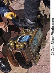 Shoeshiner at work - Particular of turkish shoeshiner...