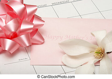 Happy Mother\'s Day - A card for mother lays on a calendar...