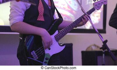 bass guitarist play on bass on corporative banquet
