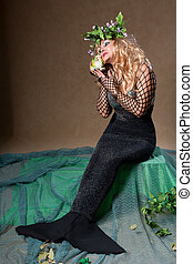Fashion Fantasy Mermaid. Studio shot on a beige background