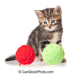 Cute little kitten with ball of threads on white background