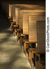 Pews in the morning light in a historic church in the...