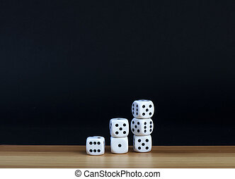 six dice on a wooden table with black background