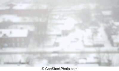 Heavy snowfall in the city in slowmotion Streets, houses and...