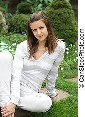 Teenager girl in the garden
