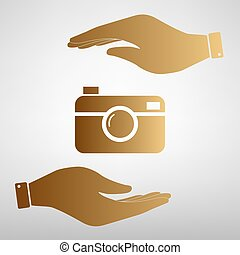 Digital photo camera icon Save or protect symbol by hands...