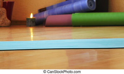 Yoga classes in hall - Female feet on mat during yoga