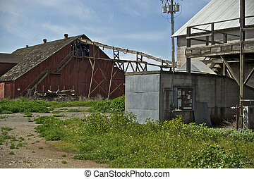 A once thriving Hops processing operation is now idle and abandoned in the Farmlands of California.