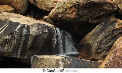 Closeup Small River Waterfall among Rocks