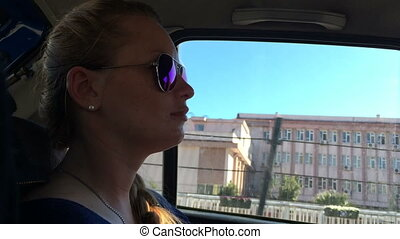 Beautiful girl with glasses in the role of a passenger...